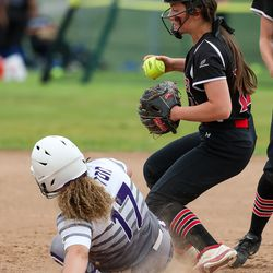 Weber second baseman Kennedie Johnson gets Riverton runner Chloe Borges out at second in a 6A softball playoff game in Spanish Fork on Tuesday, May 25, 2021.