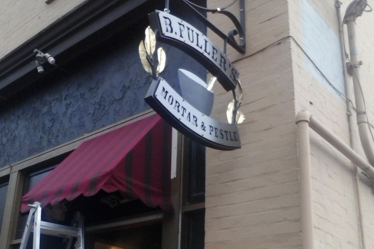 The outside of B. Fuller's Mortar and Pestle in Fremont, with a maroon awning