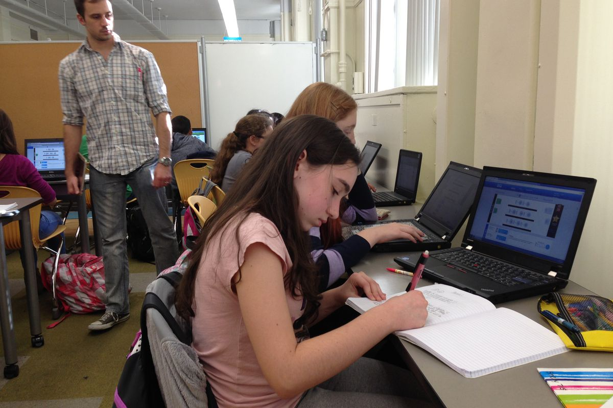 A student at I.S. 228 in Brooklyn does online work through Teach to One, a program that grew out of the iZone.
