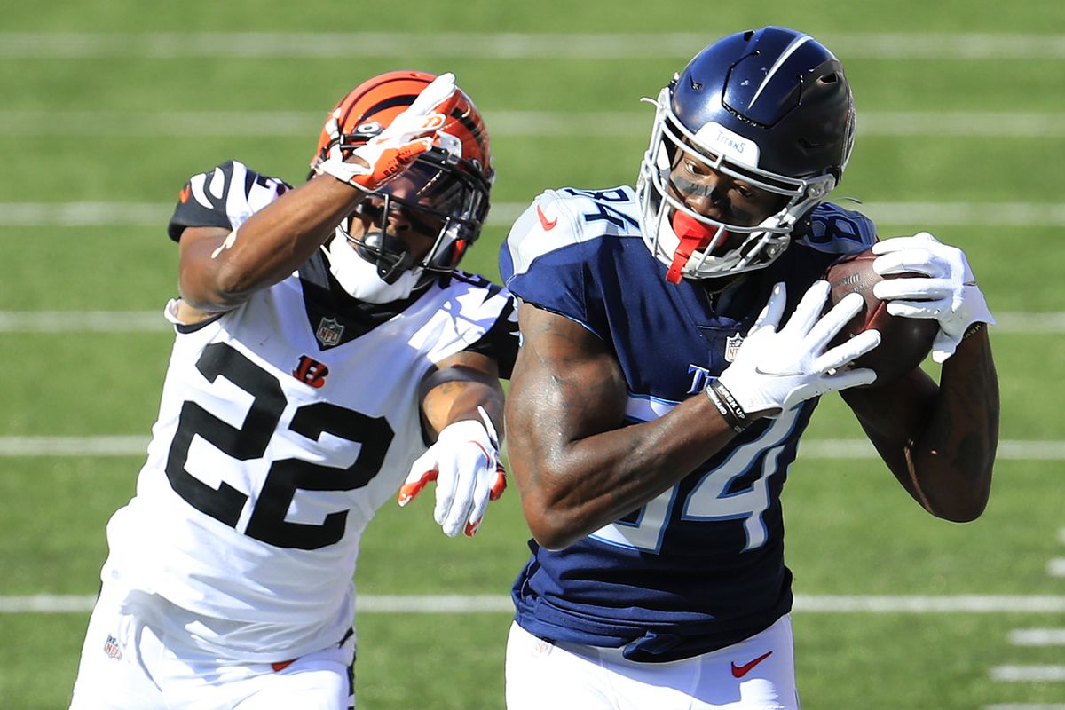 Wide receiver Corey Davis #84 of the Tennessee Titans makes a catch against William Jackson III #22 of the Cincinnati Bengals in the first quarter of the game at Paul Brown Stadium on November 01, 2020 in Cincinnati, Ohio.