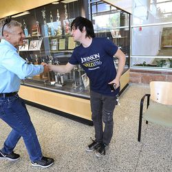Libertarian presidential candidate Gov. Gary Johnson shakes hands with Montana Jackman prior to his and running mate Gov. Bill Weld's speeches at the University of Utah on Saturday, Aug. 6, 2016.