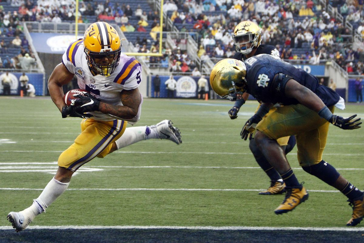 ORLANDO, FL - LSU Tigers running back Derrius Guice (5) runs in for a touchdown past Notre Dame Fighting Irish defensive back J.D. Carney (14) during the 2018 Citrus Bowl at Camping World Stadium.