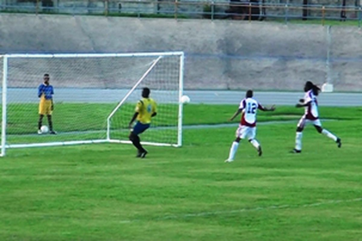 Keon Daniel scoring the first goal of a 2-0 win for Trinidad and Tobago against Barbados in a 2014 World Cup Qualifying game. (Photo courtesy of TTFF Online)