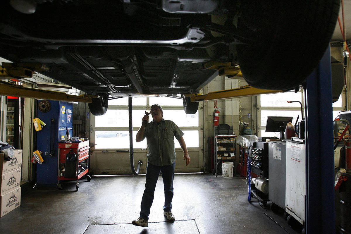 FILE - Bobby Rose conducts a safety inspection of a vehicle at the 3rd Avenue Car Clinic in Salt Lake City on Thursday, February 9, 2012. A bill eliminating mandatory vehicle safety inspections passed the Senate on Wednesday, but not before provisions wer