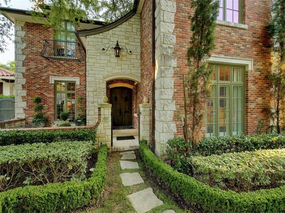 Entrance to a ... European influenced current large brick house