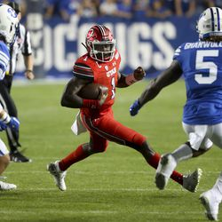Utah Kicker Tyler Huntley (1) tries to get out of trouble during the Utah-BYU football game at LaVell Edwards Football Stadium in Provo on Thursday, August 29, 2019.