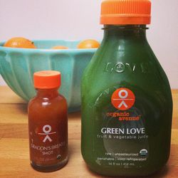 """Trying out these juices from <a href=""""http://www.organicavenue.com/""""><b>Organic Avenue</b></a>. The Dragon's Breath is intriguing; the Green Love is scary looking. But everyone's been raving about them so I have to try. Here's to health. Bottom's up!"""