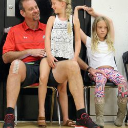 Larry Krystkowiak, head coach for the Utah Runnin' Utes basketball team, watches his sons play in a Team Camp basketball tournament with his daughters Sam and Finley at the University of Utah in Salt Lake City on Friday, June 12, 2015.