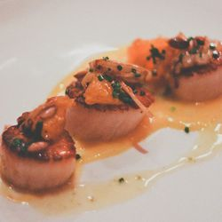 """Seared scallops with tangerine, pumpkin seeds, and fennel butter from Louro by <a href=""""http://www.flickr.com/photos/j0annie/8468324335/in/pool-eater/"""">j.anniewang</a>"""