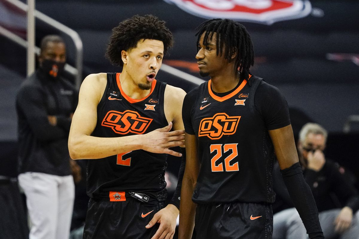 Oklahoma State Cowboys guard Cade Cunningham talks with forward Kalib Boone during the first half against the Baylor Bears at T-Mobile Center.