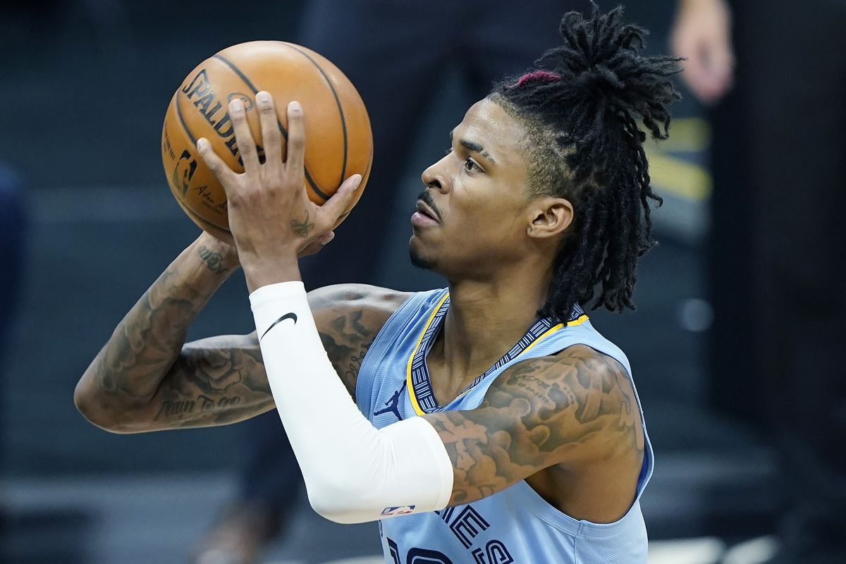 Ja Morant #12 of the Memphis Grizzlies stands at the line to shoot a foul shot against the Sacramento Kings during the second half of an NBA game at Golden 1 Center on February 14, 2021 in Sacramento, California.