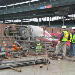Concrete truck pouring in the left-field corner on Waveland