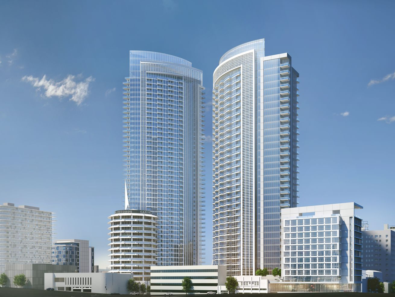 A rendering of two towers and a collection of low-rise buildings slated to rise around the Capitol Records building.