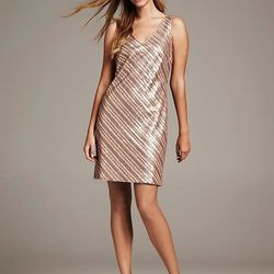 """The best thing about wearing a gold sequin dress —other than the sheer delight of gold sparkles— is that sequins are relatively stain resistant. $150 at <a href=""""http://bananarepublic.gap.com/browse/product.do?cid=1005910&vid=1&pid=969385002"""">"""