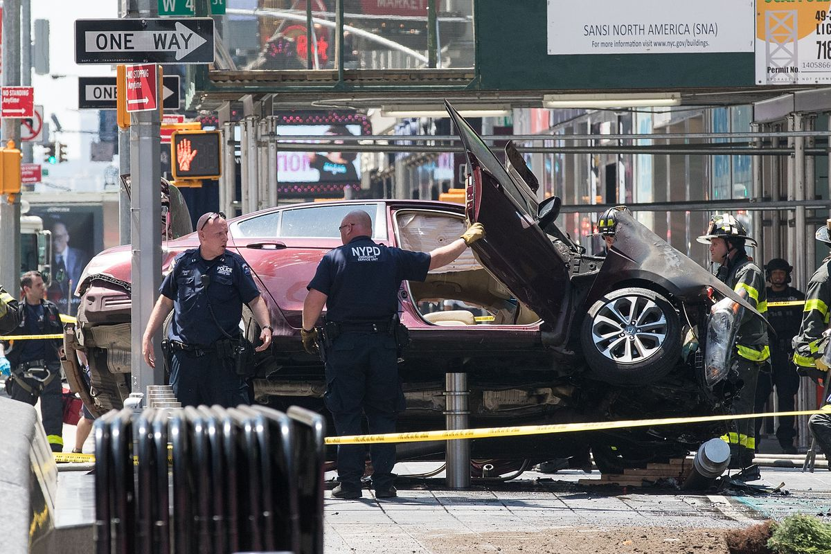 Car crashes into pedestrians in Times Square.