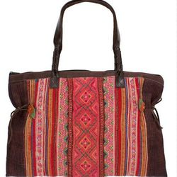 """Lighten your load with the one-of-a-kind <a href=""""http://adornbysarahlewis.com/collections/bags/products/thai-tote-bag-3"""">Thai Tote Bag</a> ($198) from Adorn. With three roomy interior pockets, this vintage piece will not only keep you organized, it'll he"""