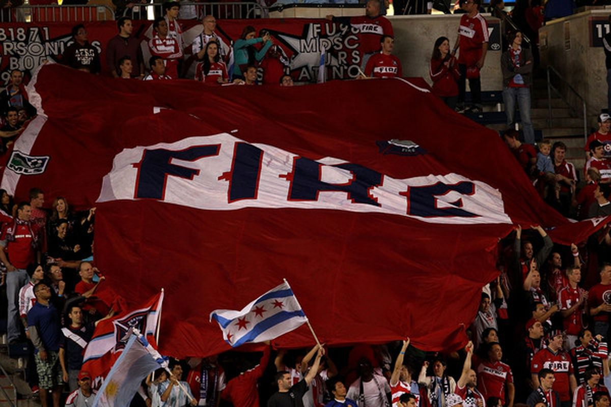 BRIDGEVIEW, IL - OCTOBER 08: Fans of the Chicago Fire celebrate a win over the Columbus Crew in an MLS match on October 8, 2010 at Toyota Park in Bridgeview, Illinois. The Fire defeated the Crew 2-0. (Photo by Jonathan Daniel/Getty Images)