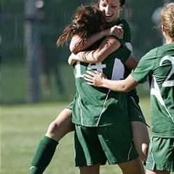 Rebecca Riddle hugs her teammates during a game against Jordan High. Hillcrest will also have some holes to fill with Riddle's departure.