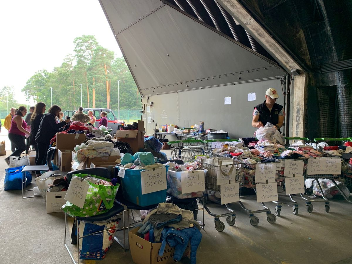 Volunteers at Ramstein Air Base in Germany organize items for Afghan refugees donated by Latter-day Saint Charities.