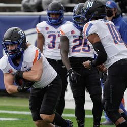 Boise State players warm up before competing against BYU during an NCAA college football game at LaVell Edwards Stadium in Provo on Saturday, Oct. 9, 2021.