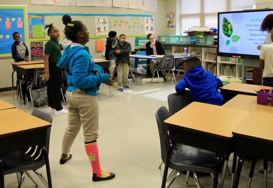 """Third-graders in Alexia Young's class go through their daily """"reading chant."""""""