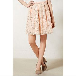 """<a href=""""http://www.anthropologie.com/anthro/product/shopsale-skirts/29469236.jsp"""">Flared Spark Skirt</a>, $67.46 (was $188.00)"""