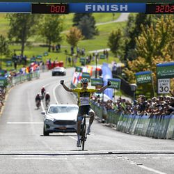 Israel Cycling Academy rider Ben Hermans celebrates as he crosses the finish line in first during Stage 3 of the Tour of Utah at Eaglewood Golf Course in North Salt Lake on Thursday, Aug. 15, 2019.