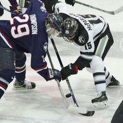 UConn's Tage Thompson (29) battle for the puck with Providence's Steven McParland (15) on a face-off.