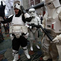 Brittanie Larsen, left, Aaron Mead and Cameron John, dressed as stormtroopers from Star Wars, attend Utah's first Comic Con at the Salt Palace Convention Center in Salt Lake City on Thursday, Sept. 5, 2013.