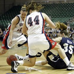 Brigham Young Cougars forward Kristen Riley (35) and Gonzaga Bulldogs forward Kelly Bowen (44) fight for the ball in the West Coast Conference finals in Las Vegas  Monday, March 5, 2012.  BYU won the title and will advance to the NCAA tournament.