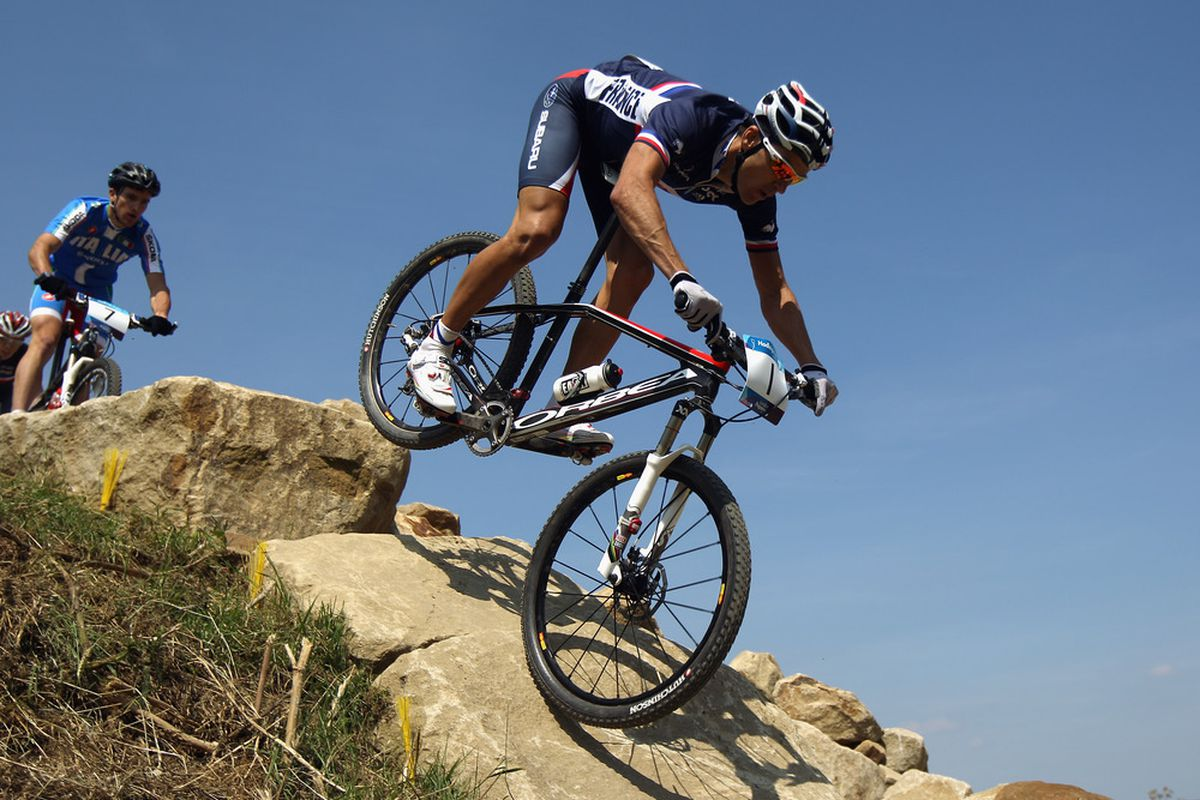 HADLEIGH, ENGLAND - JULY 31:  Julien Absalon of France in action on his way to winning the LOCOG Mountain Bike Test Event for London 2012 at Hadleigh Farm on July 31, 2011 in Hadleigh, England.  (Photo by Bryn Lennon/Getty Images)