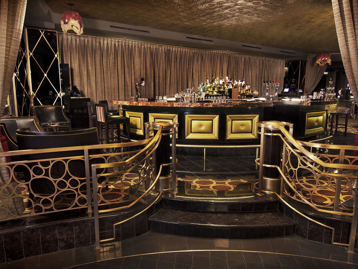 An Art Deco-inspired bar with brass touches