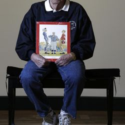 """Butch Corbett of Bennington, Vt., poses with a1950 Saturday Evening Post cover illustration """"The Toss"""" by Norman Rockwell for which he modeled at the Bennington Museum on Friday, Sept. 28, 2012, in Bennington, Vt. Corbett is the player on the left. (AP Photo/Mike Groll)"""
