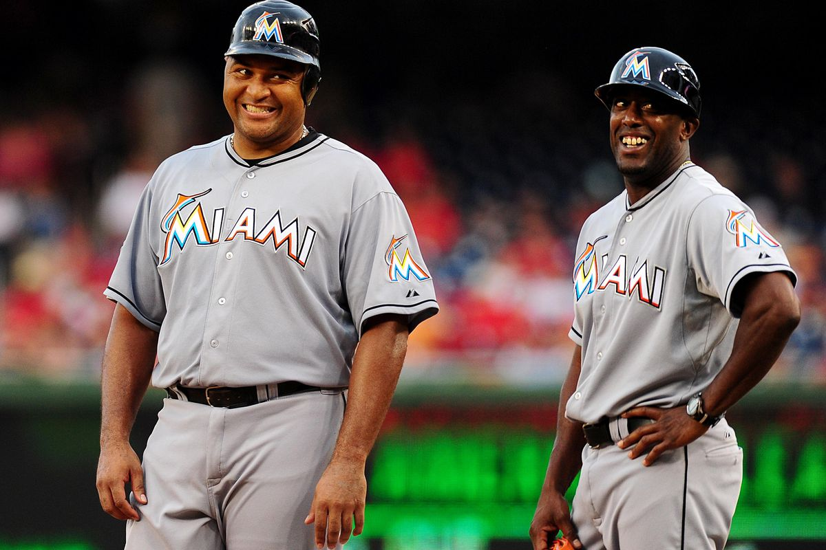 August 3, 2012; Washington D. C., USA; Miami Marlins first baseman Carlos Lee (left) and first base coach Gary Thurman (right) smiles at the Washington Nationals bench during the game at Nationals Park. Mandatory Credit: Evan Habeeb-US PRESSWIRE