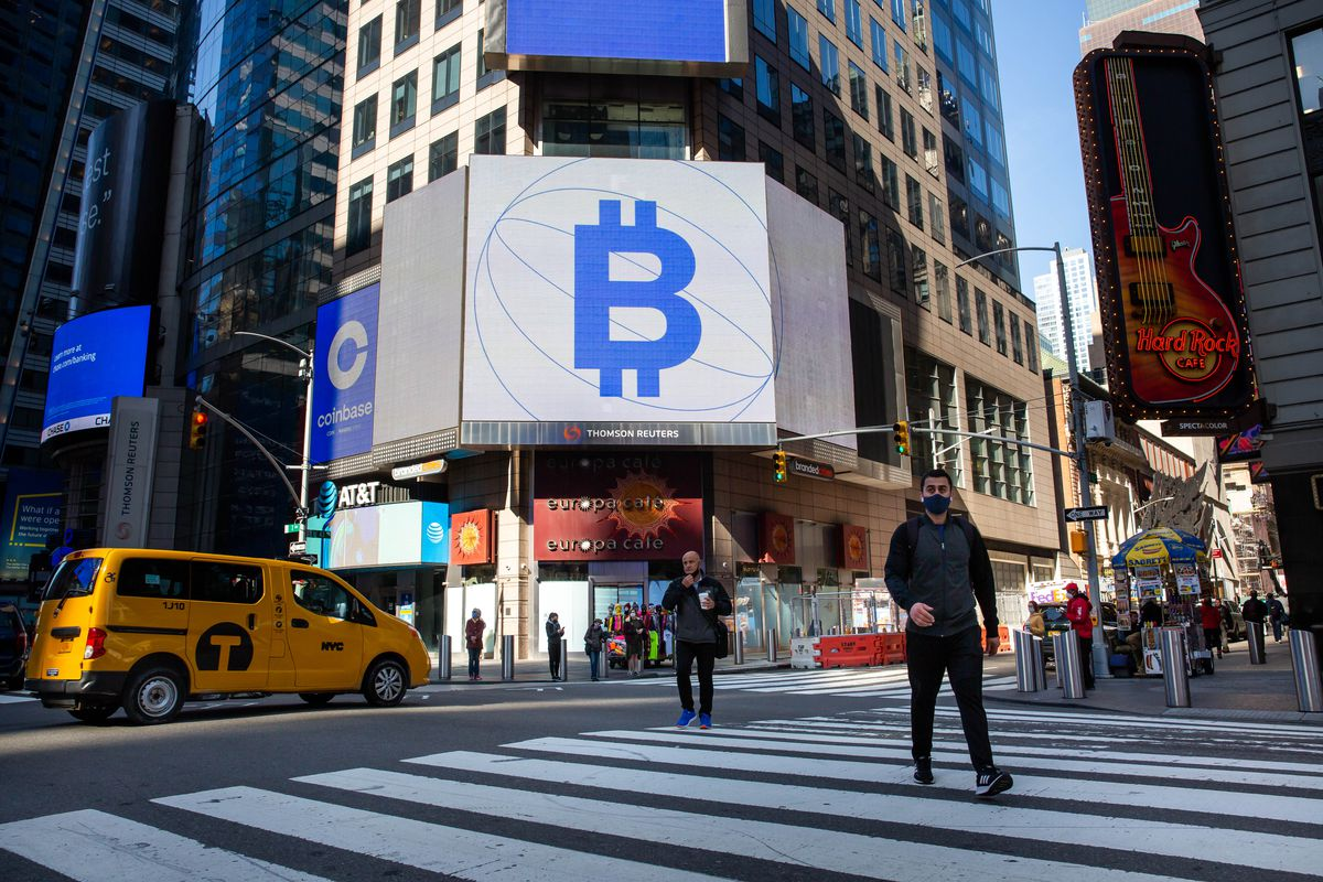 A digital sign outside the Nasdaq building in New York displays a bitcoin symbol that resembles a capital B combined with a dollar sign.