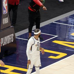 Utah Jazz guard Donovan Mitchell (45) points as he talks with Utah Jazz guard Mike Conley (10) as the Utah Jazz and the Memphis Grizzlies play in game one of their NBA playoff series at Vivint Arena in Salt Lake City on Sunday, May 23, 2021.
