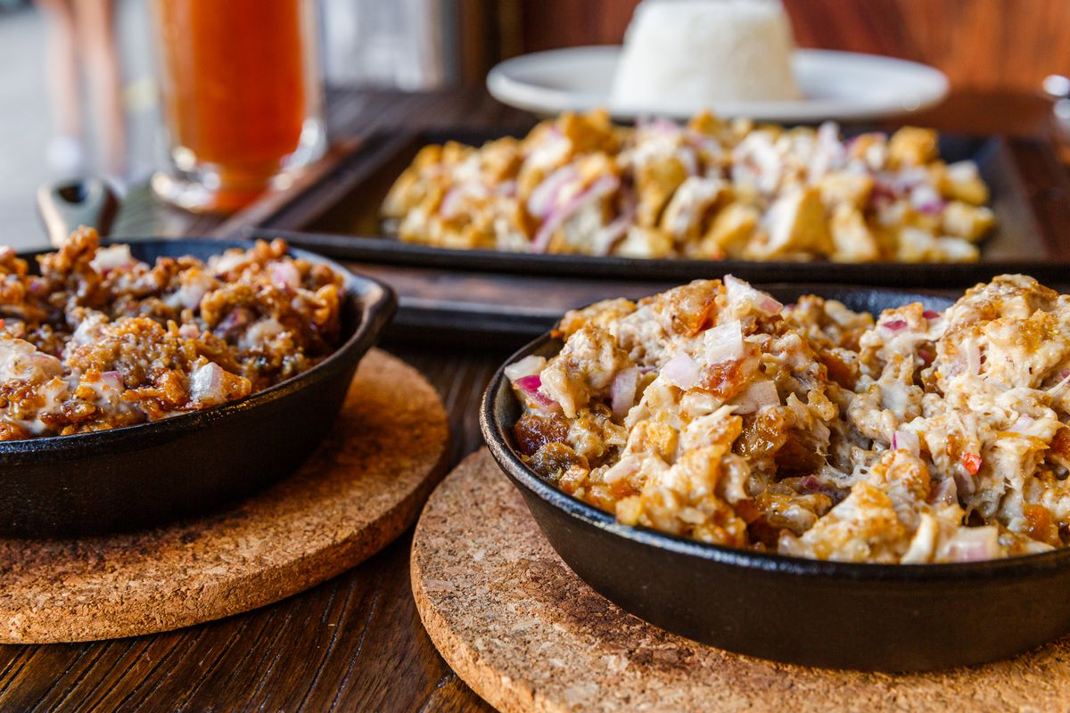 Sizzling sisig comes in a cast iron skillet.