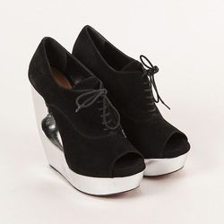 Alaia silver and black suede wedges was $595, now $395