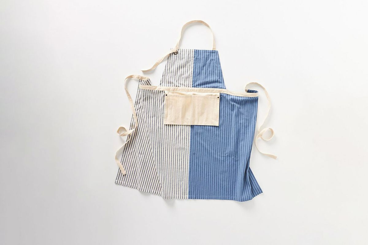 An blue and white striped apron