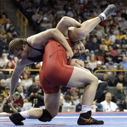 Tervel Dlagnev takes down Les Sigman, left, during their 120-kilogram freestyle final at the U.S. Olympic Wrestling Team Trials, Sunday, April 22, 2012, in Iowa City, Iowa.