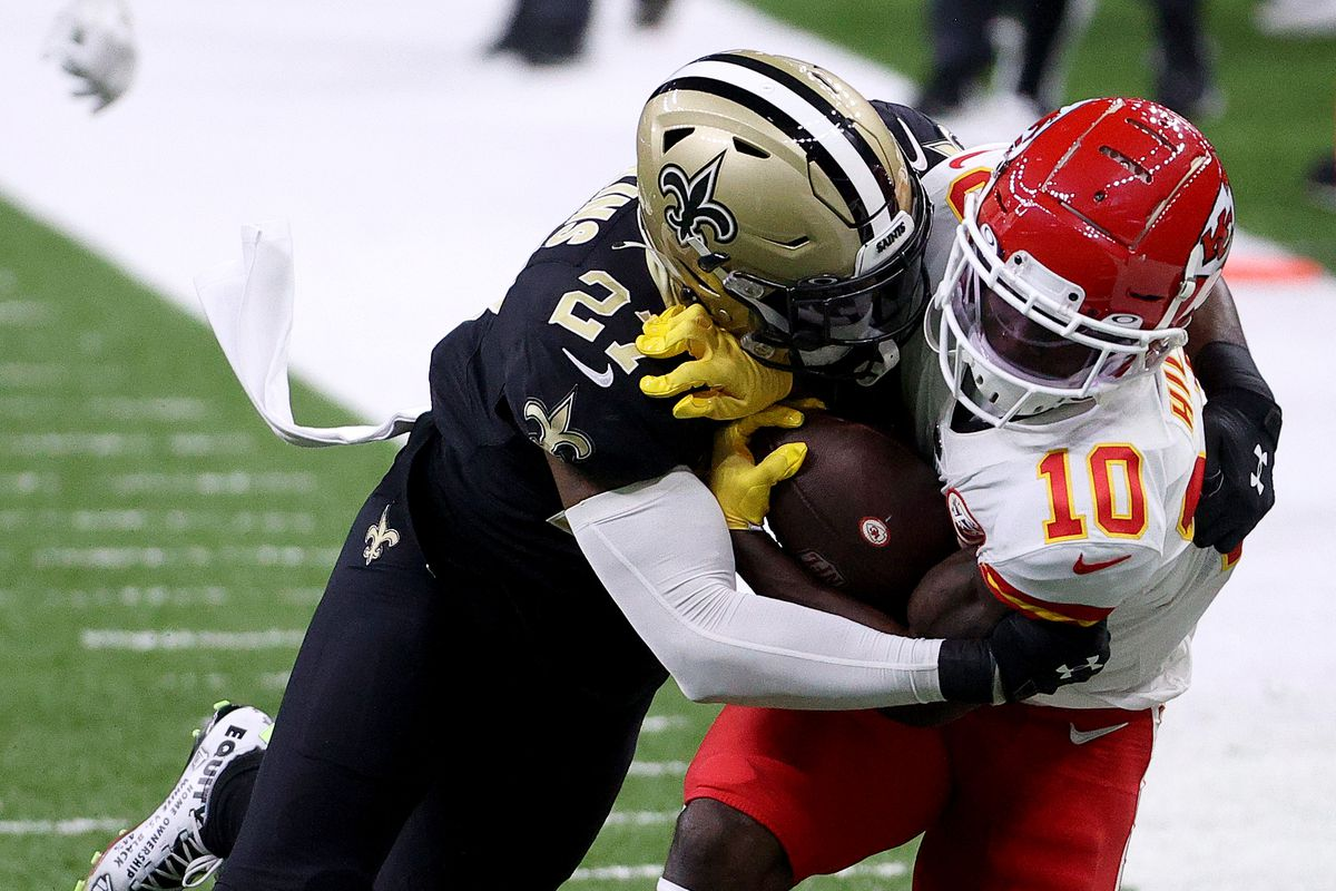 Malcolm Jenkins #27 of the New Orleans Saints tackles Tyreek Hill #10 of the Kansas City Chiefs in the game at Mercedes-Benz Superdome on December 20, 2020 in New Orleans, Louisiana.