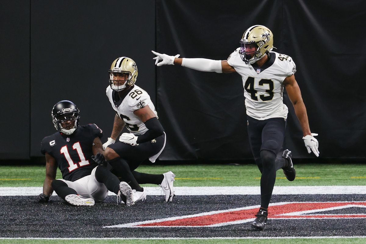 Marcus Williams #43 of the New Orleans Saints celebrates breaking up a pass to Julio Jones #11 of the Atlanta Falcons in the closing minutes of their game at Mercedes-Benz Stadium on December 06, 2020 in Atlanta, Georgia.