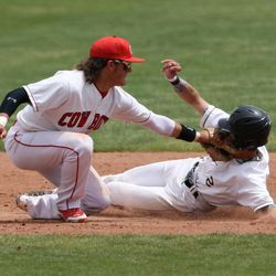 Grantsville's Wyatt Barrus, left, taps Desert Hill's Brayson Hardsman in the face during the 3A High School Baseball State Championship at Brent Brown Ballpark Saturday, May 17, 2014 in Orem.