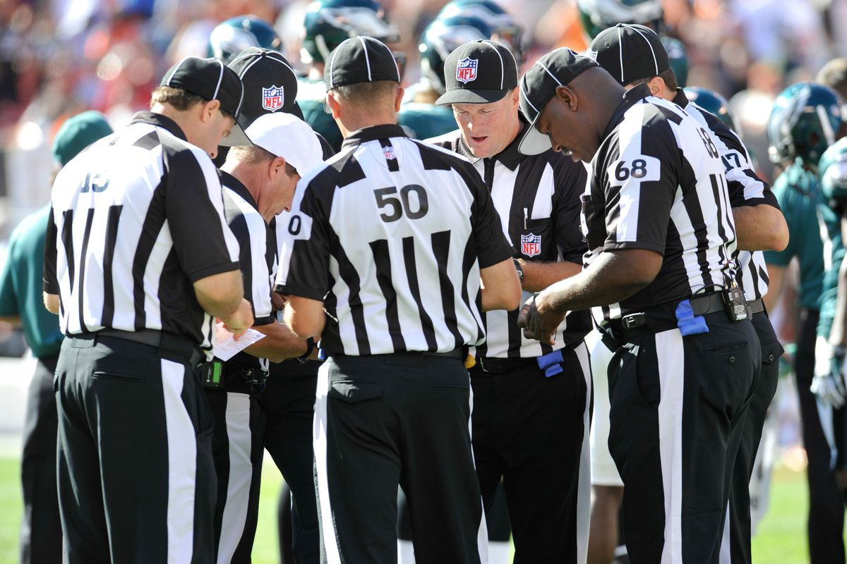 Sep 9, 2012; Cleveland, OH, USA; Referees talk during a game between the Philadelphia Eagles and the Cleveland Browns at Cleveland Browns Stadium. Philadelphia won 17-16. Mandatory Credit: David Richard-US PRESSWIRE