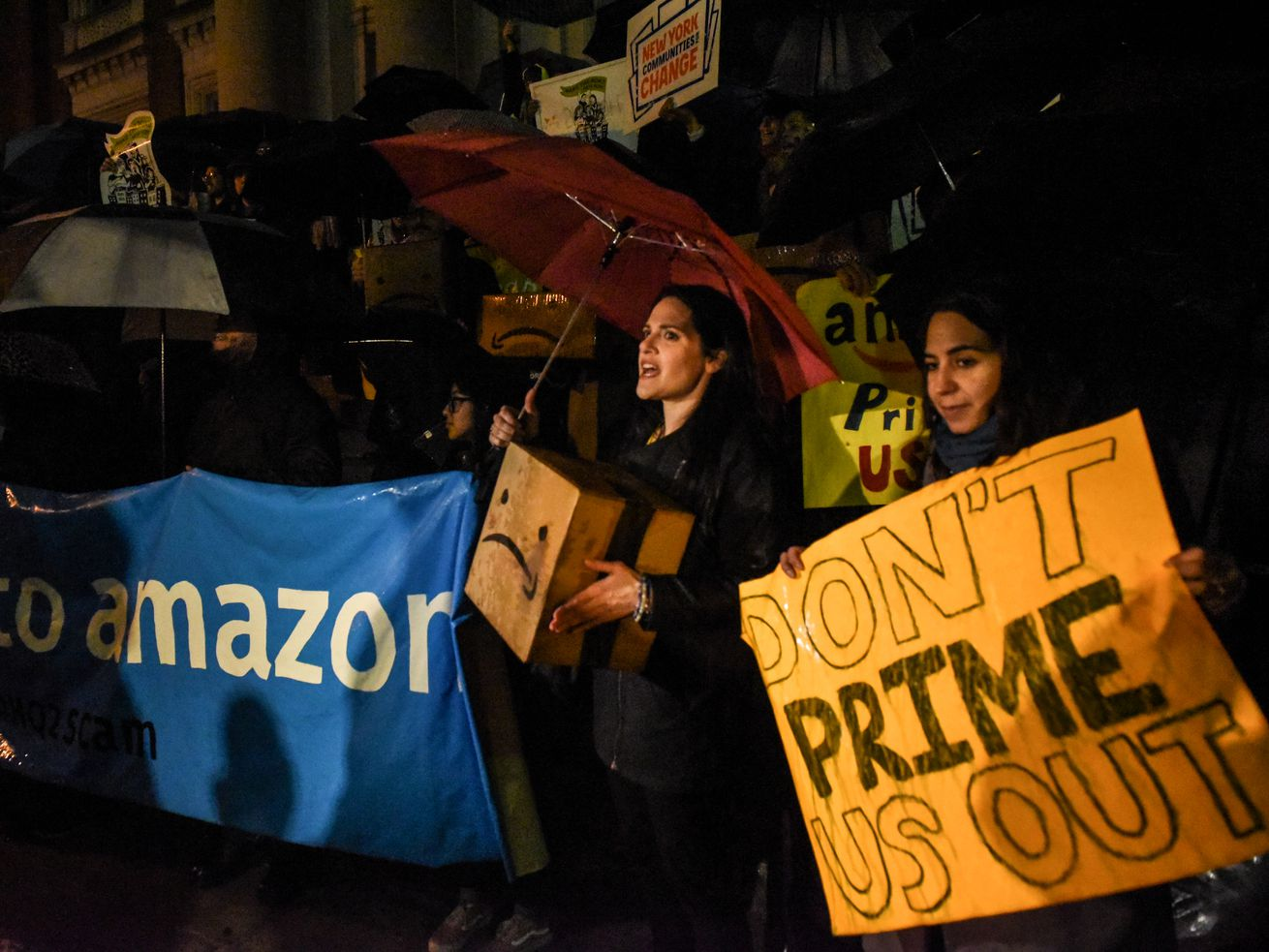 People opposed to Amazon's plan to locate a headquarters in New York City hold a protest in Court House Square on November 26, 2018, in the Long Island City neighborhood of the Queens borough of New York City.