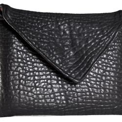 """""""The <a href=""""http://couturevulture.bigcartel.com/product/casket-clutch"""">Casket Clutch</a> ($230) handbags are a true passion project. We are starting with two clutches and hope to expand into a full line."""""""