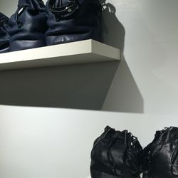 Bucket bags: Blue, $195 (from $495); black, $150 (from $375)
