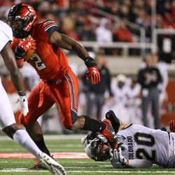 Utah Utes running back Zack Moss (2) evades the tackle from Colorado Buffaloes linebacker Drew Lewis (20) at Rice-Eccles Stadium in Salt Lake City on Saturday, Nov. 25, 2017.