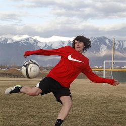 Taylor Booth poses for a portrait in Layton Thursday, March 12, 2015.