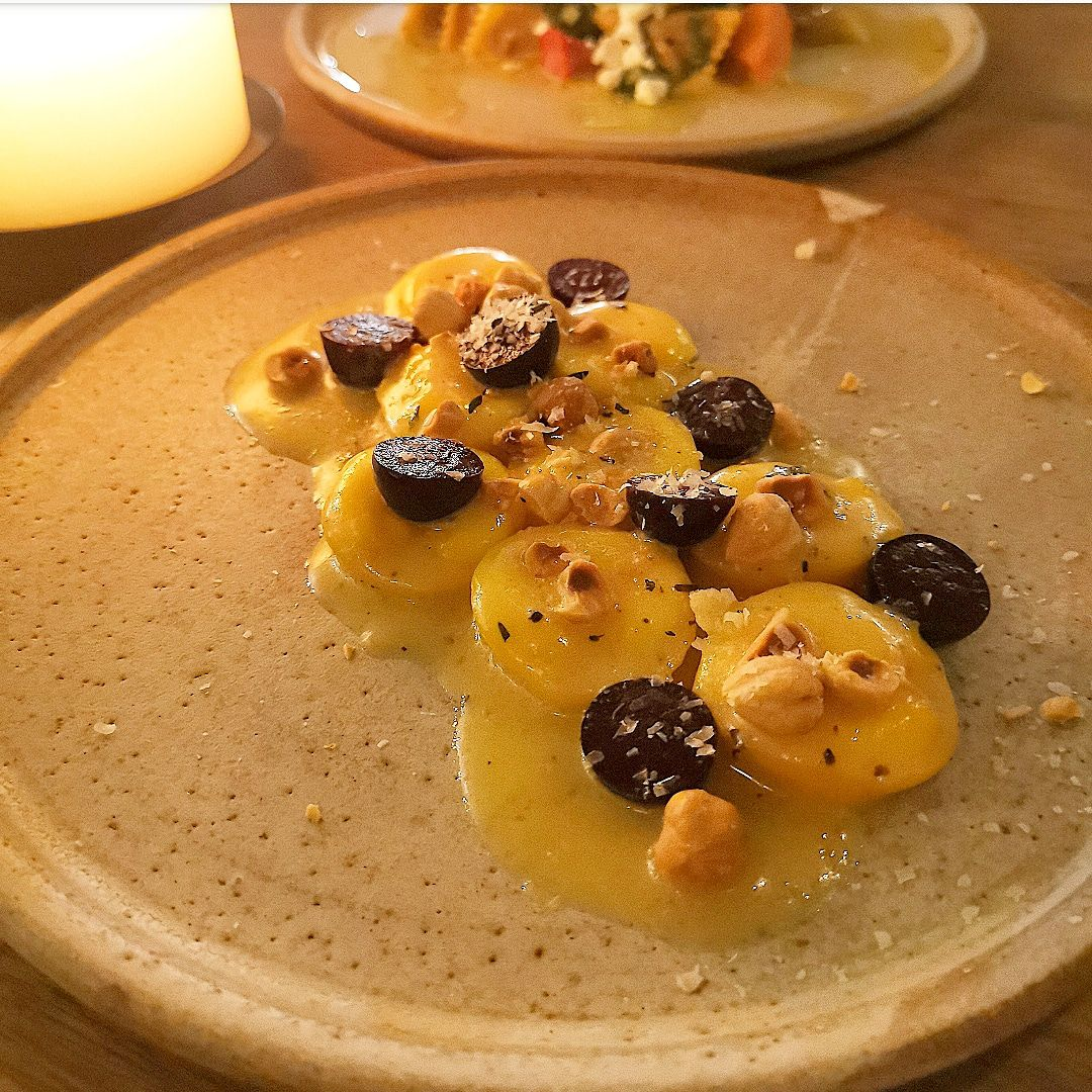Taleggio cappelletti with macerated grapes and hazelnuts at Popham's bakery in London Fields, Hackney